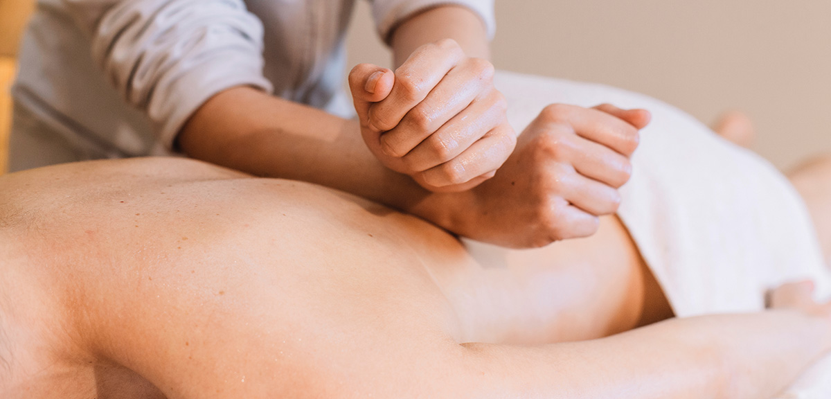 Woman Getting Shoulder and Head Massage at vancouver massage center