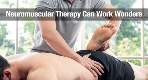 Physical therapist giving massage and stretching to athlete male